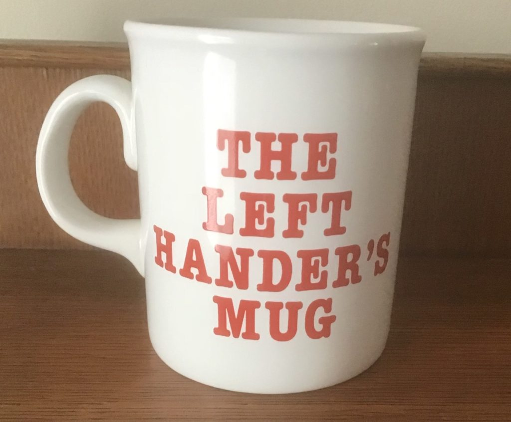 This image has an empty alt attribute; its file name is LeftHanderMug-1024x846.jpg
